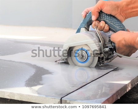 man preparing to cut tile stock photo © photography33