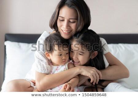 Teasing beautiful Asian woman Stock photo © stryjek