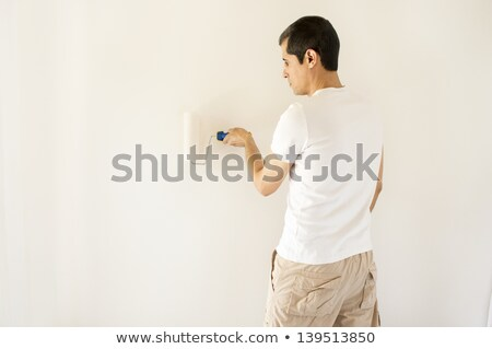 Happy tradesman painting a wall Stock photo © photography33