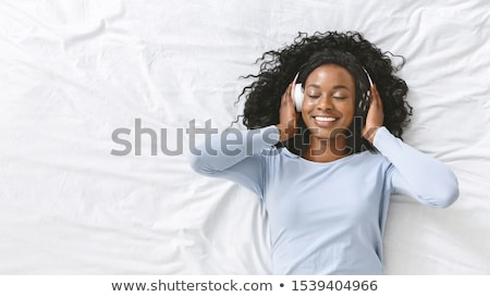 happy female laying in the bed stock photo © anna_om