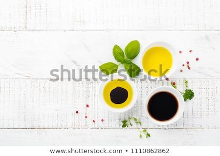azeite · vinagre · garrafas · manjericão · isolado · branco - foto stock © tannjuska