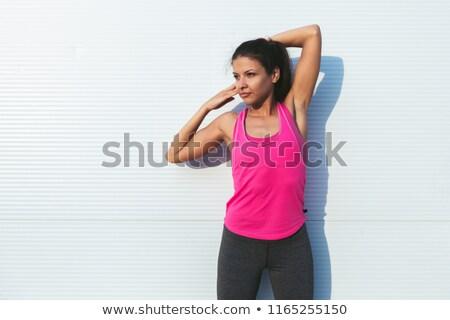 Portré sportok nő nyújtás karok fehér Stock fotó © wavebreak_media