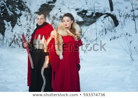 beautiful young woman in medieval clothes holding a sword stock photo © gsermek