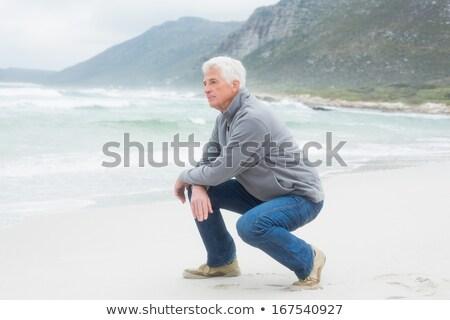 Senior man kneeling stock photo © photography33
