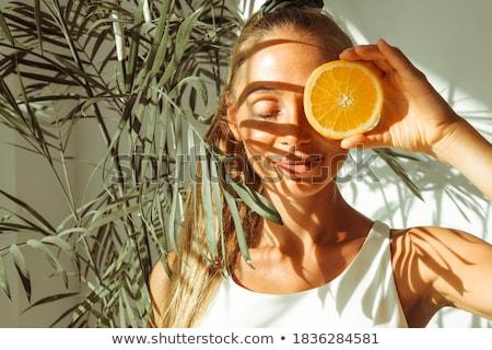 Kadın gözleri kapalı turuncu dilim genç kadın Stok fotoğraf © wavebreak_media