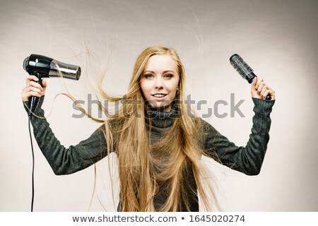 blonde woman holding hairdryer Stock photo © chesterf