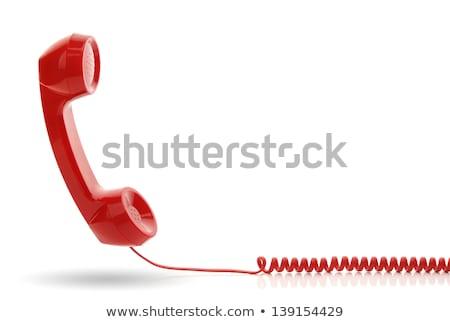 red telephone receiver on white background stock photo © pxhidalgo