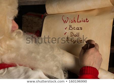 kerstman · vergadering · home · schrijven · oud · papier · rollen - stockfoto © HASLOO