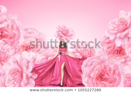 portrait of a young girl with rose petals stock photo © mizar_21984