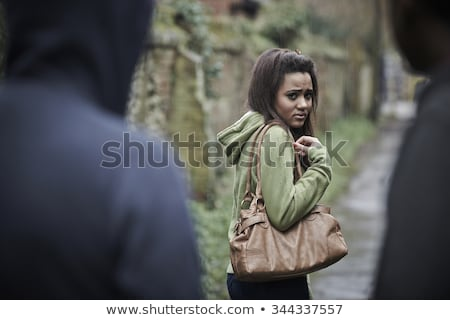 teenage girl feeling intimidated as she walks home stock photo © highwaystarz