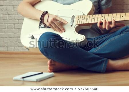 piękna · młoda · kobieta · kanapie · gitara · muzyki · strony - zdjęcia stock © feelphotoart
