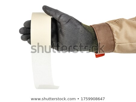 Male worker's hand holding roll of sticky adhesive paper tape Stock photo © stevanovicigor