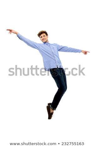 Fiatal férfi táncos pózol lábujjak fehér Stock fotó © deandrobot