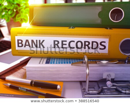 red ring binder with inscription bank records stock photo © tashatuvango