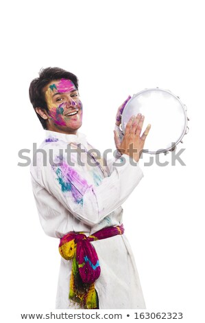 man celebrating holi with playing tambourine stock photo © imagedb