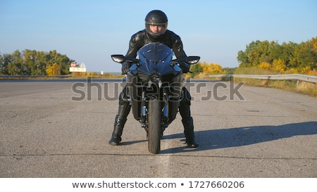motorcyclist goes on road front view stock photo © paha_l