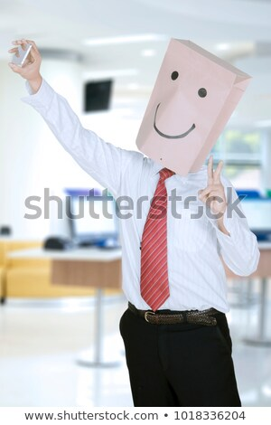 young man with a paper bag in his head taking a selfie Stock photo © nito