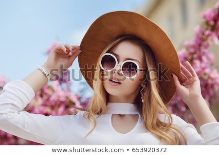Beautiful lovely blonde with flower hair accessory on the street Stock photo © vlad_star