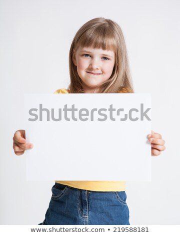 Beautiful blonde with the inscription on the white paper 'Happiness'. stock photo © ANessiR