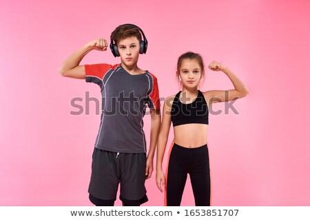 teenager showing biceps stock photo © zurijeta