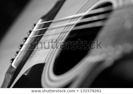 Stock photo: Close up of classic guitar with shallow depth of field