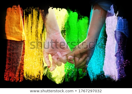 Stock photo: close up of male gay couple with rainbow flags