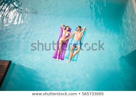 homem · flutuante · inflável · colchão · piscina · verão - foto stock © dash