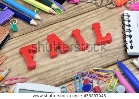 Fail word and office tools on wooden table Stock photo © fuzzbones0
