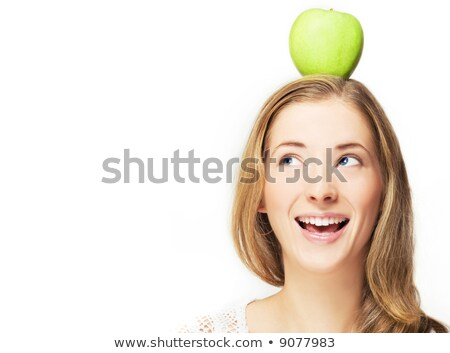 funny cute young woman with apple on her head stock photo © deandrobot