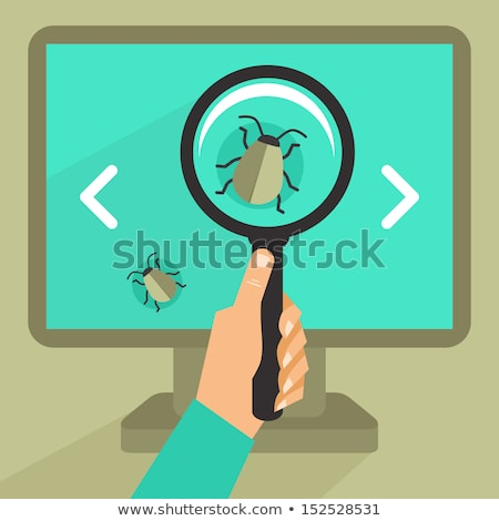 Searching for bug, virus. magnifying glass with computer Stock photo © Photoroyalty