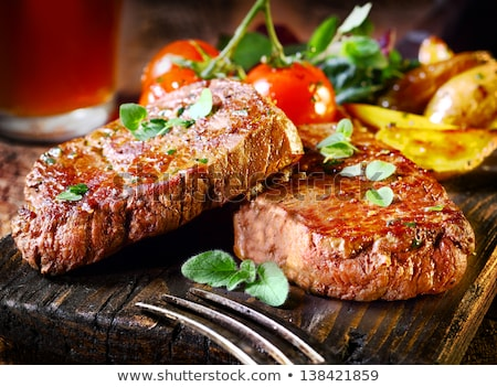 succulent thick grilled beef steak stock photo © artjazz