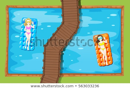 Two women on floating mat in the pool Stock photo © bluering