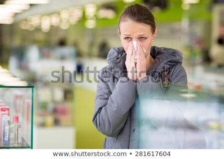 jonge · vrouw · blazen · neus · moderne · apotheek · kiezen · pillen - stockfoto © lightpoet
