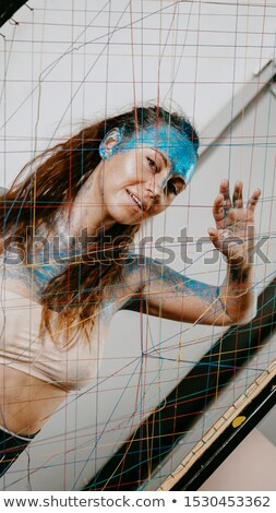Portrait of beautiful woman with blue sparkles on her body Stock photo © deandrobot