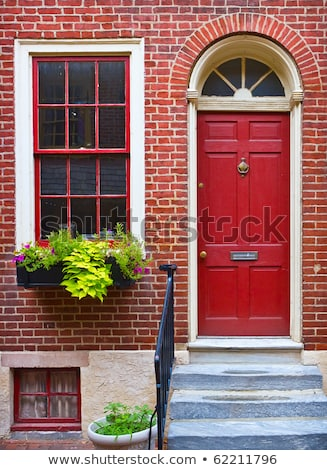 old fashioned style building with red door stock photo © bluering