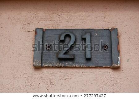 Domu numer starych budynku podkowy Zdjęcia stock © Klinker