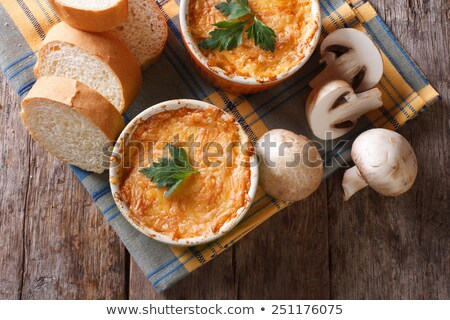 Casserole with chicken and mushrooms  julienne on the table. top Stock photo © Yatsenko