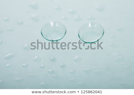 Two transparent soft contact lenses lie on the lens Stock photo © krugloff