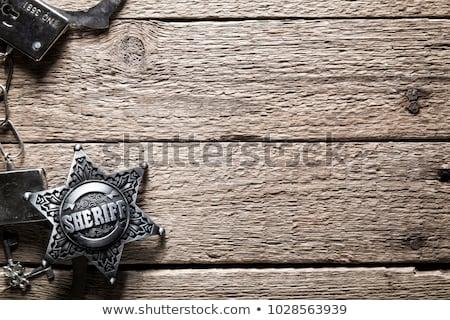 handcuffs on wooden background stock photo © stevanovicigor