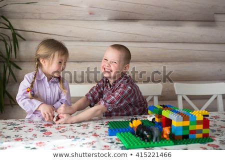 Family sitting on wall sharing photos Stock photo © IS2