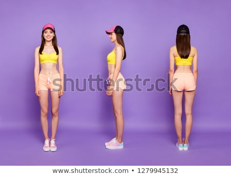 Full length back view portrait of a young fitness woman Stock photo © deandrobot