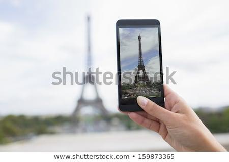 женщину фотография Эйфелева башня телефон городского Сток-фото © IS2