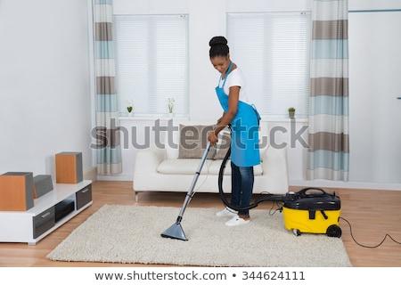 Fiatal afrikai nő takarítás porszívó boldog Stock fotó © RAStudio