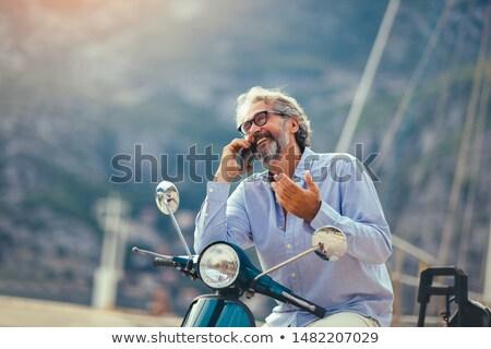Középkorú pár motorcsónak férfi szabadság mosolyog Stock fotó © IS2