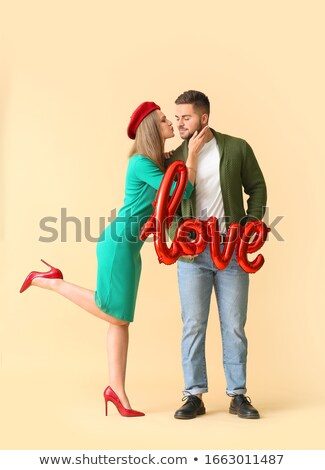 Stock photo: Couple with shaped balloon of word Love