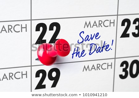 wall calendar with a red pin   march 22 stock photo © zerbor