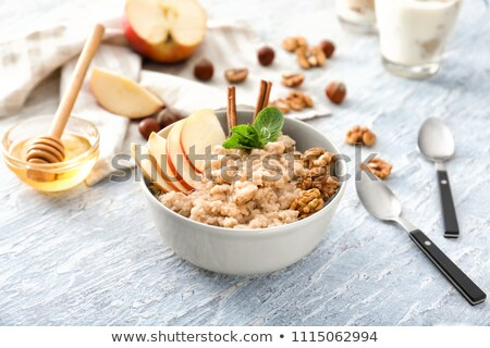 spoon of oatmeal porridge with apples and walnuts Stock photo © Digifoodstock