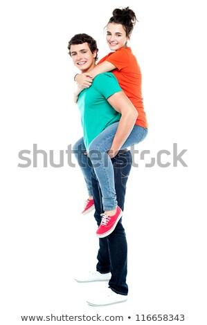 vriendin · op · de · rug · gelukkig · paar · achtergrond - stockfoto © is2