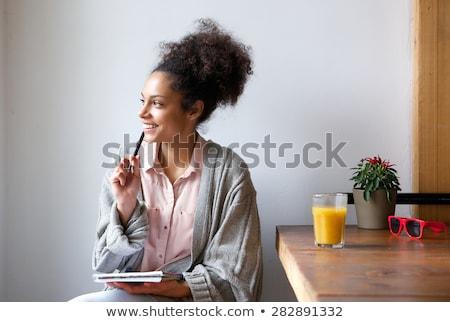 Portre konsantre genç kadın çalışma dizüstü bilgisayar belgeler Stok fotoğraf © deandrobot