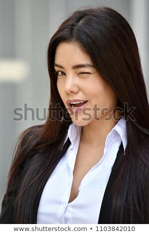 Iş kadını genç kadın beyaz gülümseme silah Stok fotoğraf © filipw
